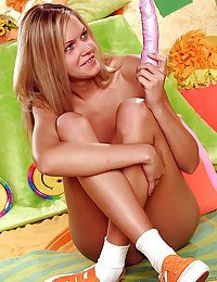 Hot sweetie playing with a pink vibrating dildo in her pussy