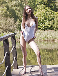 Vigorous feminine beauty with huge natural breasts is wearing sexy tight clothing while enjoying her and the nature.
