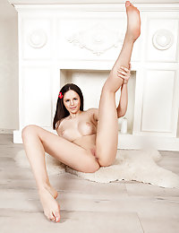 Beyond attractive slender babe posing and playing naked after getting rid of her clothes and knee socks.