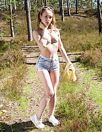 Amazing looking redhead teen gets off her jeans shorts and white shirt to reveal her perfect naked body.