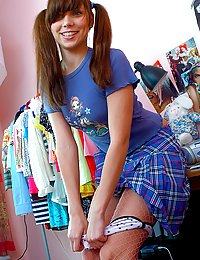 Brunette schoolgirl with pigtail exposes her sweet body
